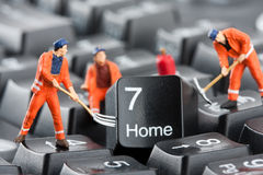Workers repairing keyboard Royalty Free Stock Photo
