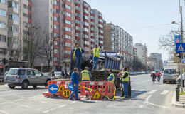Workers repairing potholes on a main street in Bucharest Stock Images