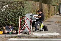 Workers repairing relationship communications cable connection. Strasbourg, France - September 18, 2017: Workers repairing bonding communications wireman royalty free stock image