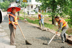 Workers are repairing road Stock Photos