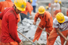 Workers are repairing road Royalty Free Stock Image
