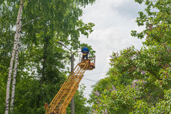 Workers repairing street lights Royalty Free Stock Image
