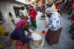 Workers repairing of Stupa Boudhanath, Dec 3, 2013 in Kathmandu, Nepal. Stock Photography
