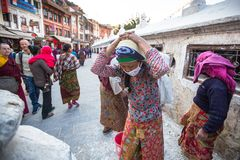 Workers repairing of Stupa Boudhanath,in Kathmandu, Nepal. Stock Photos