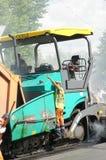 Workers repairs road Stock Images