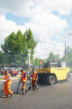Workers repairs road Stock Photo