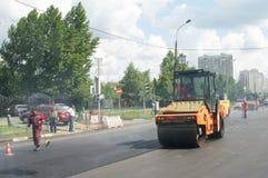 Workers repairs road Stock Photos