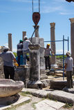 Workers restore ancient column Stock Image
