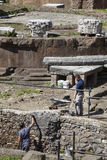 Workers restorers. Republican Roman temples, and the remains of Pompeys Theatre Royalty Free Stock Photos