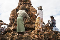 Workers restoring a stupa in Myanmar. Royalty Free Stock Photo