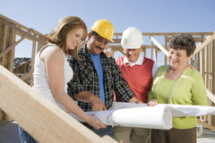 Workers Reviewing Blueprint Royalty Free Stock Photos
