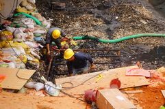 Workers in the river construction, pry an iron shelf Royalty Free Stock Image