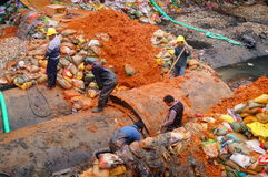 The workers are on the river drainage pipeline maintenance Royalty Free Stock Photo