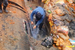 The workers are on the river drainage pipeline maintenance. In Shenzhen, china Royalty Free Stock Image