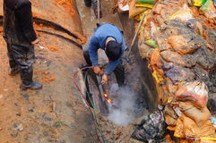 The workers are on the river drainage pipeline maintenance. In Shenzhen, china Royalty Free Stock Photography
