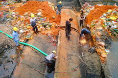 The workers are on the river drainage pipeline maintenance. In Shenzhen, china Royalty Free Stock Photos