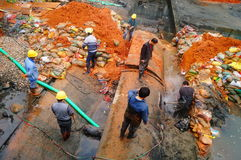 The workers are on the river drainage pipeline maintenance. In Shenzhen, china Stock Image