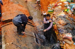 The workers are on the river drainage pipeline maintenance. In Shenzhen, china Royalty Free Stock Photo