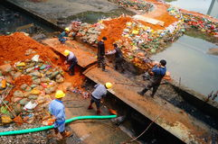 The workers are on the river drainage pipeline maintenance. In Shenzhen, china Stock Photos