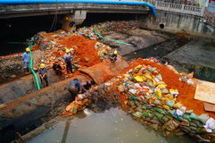 The workers are on the river drainage pipeline maintenance. In Shenzhen, china Stock Images