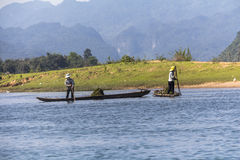 Workers on river in Vietnam. Workers on river of Phong Nha in Vietnam Royalty Free Stock Photography