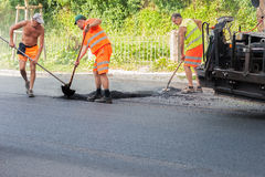 Workers on a road construction, industry and teamwork royalty free stock photo
