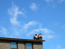 Workers on roof. Two men working on roof Stock Photo