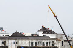 Workers on the roof Royalty Free Stock Image