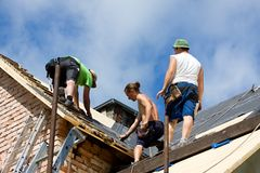 Workers on the roof Stock Photography