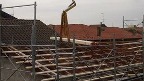 Workers on a roof stock video footage