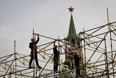 Workers in Russia. As in a '30 avant-garde collage, workers build an infrastructure in the Red Square of Moscow royalty free stock images