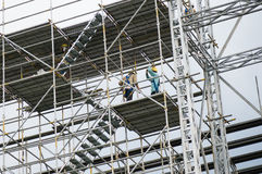 Workers on a scaffold. Construction workers on a scaffold Royalty Free Stock Photography