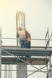 Workers on scaffold platform tied rebar and steel bars 2 Royalty Free Stock Photography