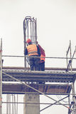 Workers on scaffold platform tied rebar and steel bars 3 Stock Photography