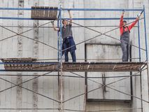 The workers on the scaffolding. Workers on construction sites. Russia. Saint-Petersburg. Summer 2017. stock photo