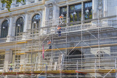 Workers on scaffolding Stock Images