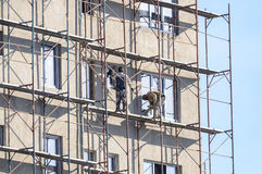 Workers on scaffolding Stock Photo