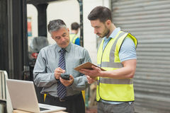 Workers scanning package in warehouse Royalty Free Stock Photos