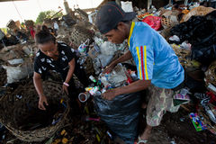Workers in a scavenging at the dump Stock Photo