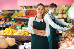 Workers selling fresh fruits Stock Photography