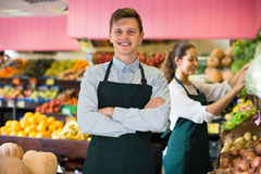 Workers selling fresh fruits Royalty Free Stock Image