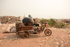 Workers separate waste for sale.Separate garbage collection. Rec Stock Images