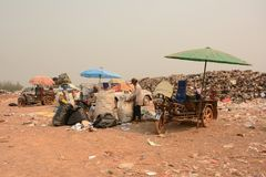 Workers separate waste for sale.Separate garbage collection. Rec Royalty Free Stock Image