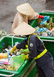 Workers separates the waste on the street for recycling Royalty Free Stock Images