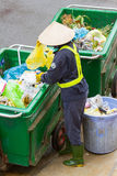 Workers separates the waste on the street for recycling Stock Image