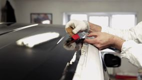 Workers at the service station is further processed edge vinyl special dryer. stock video