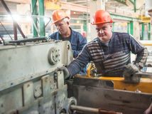 Workers set up equipment Royalty Free Stock Image