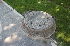 Workers sewer hole in ground Stock Image