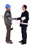 Workers shaking hands Royalty Free Stock Photos