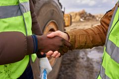 Workers Shaking Hands Outdoors Closeup royalty free stock photos